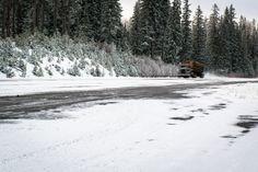 Logging truck on snow - Logging truck transporting freshly harvested trees over snowy roads in NE Oregon.