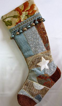 Christmas stocking in blue and taupe Victorian quilt patchwork with white star and trim