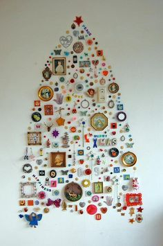 "Jane's Wall Collection Christmas Tree by alltheluckintheworld via apartmenttherapy: Composed of ""useless but pretty objects"" collected over the years and arranged into something that is one part art and one part decor.  #Christmas_Tree #Wall_Decor #Upcycle"
