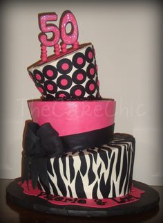 Sassy topsy turvy - Fabulous 50 Cake.  Chocolate cake filled in Oreo cream and French Vanilla cake filled in Caramel cream filling.  Iced in buttercream.  Fondant acccents.