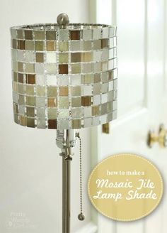 Want to make a lamp shade that will bring some style and bling to your home? All you need are a few mosaic tile sheets, a lamp shade top piece, and some thread. In no time you'll have a beautiful Mosa Mosaic Tile Sheets, Mosaic Tiles, Diy Luz, Luminaria Diy, Diy Luminaire, Make A Lamp, Tile Crafts, Tile Projects, Room Lamp