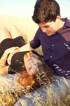 Girl lays on guy's lap in field.  Redding, California  Sara Faith Photography » Professional Photography » Portraits