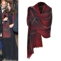 The Duchess of Cambridge was first spotted wearing this luxurious shawl on Christmas Day 2013 while heading to communion with other members of the royal family in Sandringham. The Really Wild Clothing scarf is made from a cashmere wool blend in a warm tartan consisting of claret red and navy blue checks.
