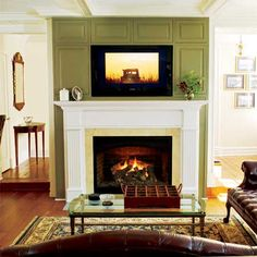 I don't really like tvs over fireplaces but this is better done than most. Photo: Wendell T. Webber | thisoldhouse.com | from A Detail-Oriented Renovation and Addition
