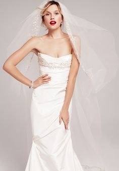 An elegant embroidered bodice provides the pièce de résistance on a beautifully draped taffeta gown.