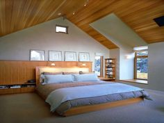 Proper Attic Conversion Ideas into a Good Bedroom on Your Home: Beauteous Attic Bedroom Ideas Popular Contemporary Master Bedroom Decorating With Wooden Sloped Ceiling Over Full Size Wooden Very Low Bed Also Simplistic Furnishings Design ~ workdon.com Bedroom Design Inspiration