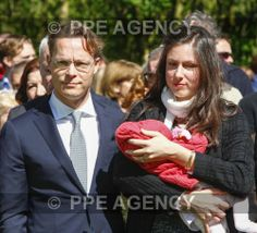 Noblesse & Royautés:  Prince Jaime of Bourbon Parma with his wife Princess Viktoria holding their baby daughter Princess Zita, spoke at the remembrance ceremony at the National Monument to Dachau in Amsterdam, April 2014.  The prince's grandfather Prince Xavier of Bourbon Parma was a prisoner at Dachau.