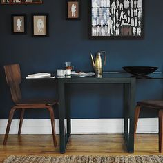 I actually like the blend in table with that large white baseboard. It gives the illusion of more open space!
