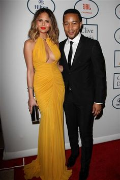 John Legend and Chrissy Teigen attend Clive Davis' 2014 Pre-Grammy Gala & Grammy Salute to Industry Icons at The Beverly Hilton Hotel in Los Angeles on Jan. 25, 2014.