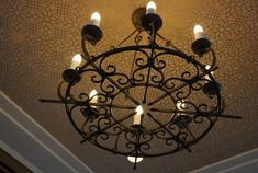 The Saratoga Rustic Round Iron Chandelier is a round wrought iron chandelier. Features a circle base & scrolled curves. 1920s chandelier. Rustic Chandelier.