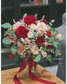 I like the contrast of pale pink Camay roses against the dark red and the silvery green of the Eucalyptus. Ideal for a December wedding Small Wedding Bouquets, Red Bouquet Wedding, Floral Bouquets, Floral Wedding, Prom Flowers, Silk Flowers, Wedding Flowers, Rose Wedding, Beautiful Flower Arrangements
