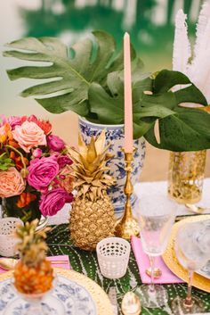 banana leaves and tall gold candlesticks. pink, peach, pineapple wedding inspiration | lovelyfest event design