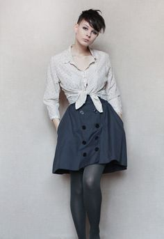 Buttoned navy skirt and tied blouse
