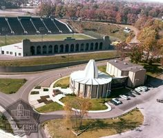 September 7, 1963 – The sparkling new 19,000-square-foot, two-building Pro Football Hall of Fame was officially opened. The charter class of 17 enshrinees was inducted that day. Fawcett stadium sets in the back ground where Canton's 4 high school football teams played.