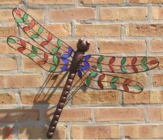 Hand crafted Stained Glass Dragonfly faccents a bare spot beautifully! Whimsical decor for home or garden, large dragonfly will grace the environment with natural charm. Unusual design with vibrant re