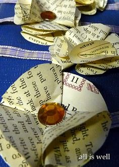 Paper rosettes made from recycled book pages  (Source: Paper Rosettes : All is well blog)