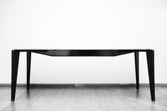 JEAN PROUVÉ TABLE PHOTOGRAPHED BY ADRIEN DIRAND FOR JOUSSE ENTREPRISE GALERIE