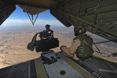 A German Air Force aerial gunner sits on the ramp of a German Air Force CH-53GS helicopter while flying over southern Arizona during Angel Thunder 2015, June 7, 2015. Angel Thunder is the world's largest personnel recovery exercise. D-M hosted 11 partner nations and nine interagencies with a common goal to train personnel recovery forces to prepare, plan, execute and adapt for rescue missions. (U.S. Air Force photo by Airman 1st Class Chris Massey/Released)
