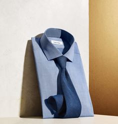 Fact: Classic office style doesn't get any better than a fresh indigo dress shirt and tie, Calvin Klein