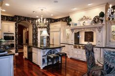 Luxury Black and White Kitchen with Wood Floors