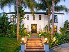 Los Angeles, Calif.  Impeccably maintained since its construction in the 1920s, this Hancock Park abode is located on a corner lot and surrounded by lush, tropical landscaping and tall palm trees