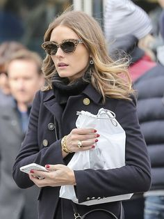 Olivia Palermo chose a pair of stylish cateye shades for her retro-inspired look while out in NYC.