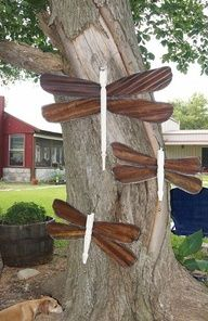 I love decorations that pop yet blend with nature, dont you? These are perfect -- Dragonflies made from tin from an old barn and spindles