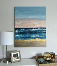 Original abstract painting done in bright, beautiful silver and gold tones with pink, navy, gray and white hues all in acrylic paints. An abstract seascape, with ocean blues and sunset pinks. A great way to add beautiful color and texture to any space in your home or office. Dimensions: