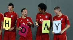 REUTERS: Bayern Munichs Mario Mandzukic (from L to R), Franck Ribery, Dante and Bastian Schweinsteiger joke during a team photo call in Munich July 30, 2012. REUTERS/Michaela Rehle (GERMANY - Tags: SPORT SOCCER)