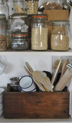 kitchen shelves. I love vintage wooden crates, and what better way to use one? I use them for everything, but never thought of this!!