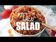 The perfect Taco Salad for a potluck or party! This Doritos Taco Salad is always a hit anywhere I bring it and we've been serving it my entire life.