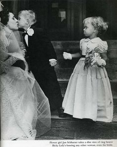 Flower girl Jan Schlueter takes a dim view of ring bearer   Ricky Lofy's bussing any other woman, even the bride.