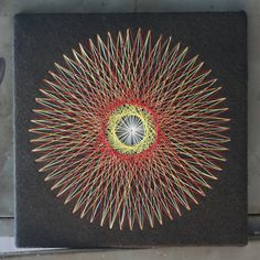 A variation of string art. I wish they still made these kits! Why were the seventies so awesome =)    Vintage Sunrise String Art by thriftykitten on Etsy, $29.00