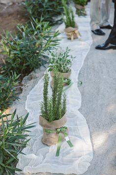 Στολισμός με λινάτσα και λουλούδια στα παράθυρα της εκκλησίας και στην πόρτα. See Full Post Photography by YIANNIS SOTIROPOULOS