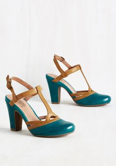 On your mark, get set, now strut through the rooftop party in these fabulous heels by Miz Mooz! These classic kicks sport a coffee-colored T-strap and flirty cutouts atop a teal blue, leather construction, making each step in these pumps a stylish one.