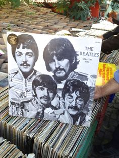 """Beatles """"Greatest Hits."""" Here's an interesting album that I found during a trip to Ankara, Turkey last year. It's an album of The Beatles """"Greatest Hits."""" Of course there never was such a thing and this was a total pirate copy. For all I know it wasn't even their music on the vinyl record inside."""" #TheBeatles #vinyl #recording"""