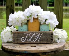 RUSTIC WEDDING CENTERPIECE, Yellow and Mint painted mason jars and planter is monogrammed. Beautiful for rustic or shabby chic wedding! by TheSouthernBlend on Etsy https://www.etsy.com/listing/244460983/rustic-wedding-centerpiece-yellow-and