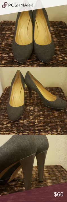 Kate Spade grey pumps Dark grey soft material with silver leather heel. Small scuffs on inside of right heel not noticeable. kate spade Shoes Heels