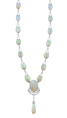 Platinum, Opal and Diamond Necklace One oval opal ap. 15.50 cts., one round & 16 oval opals ap. 54.00 cts., one drop-shaped opal ap. 24.0 x 9.0 mm., c. 1910. Length 22 inches.