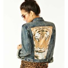 """Somedays Lovin Wild One Denim Jacket XS Rad acid-washed denim jacket featuring chest pockets and a tiger print at back. Button closures at front and cuff. Awesome tossed over a vintage tee and body-con skirt! By Somedays Lovin'.  *100% Cotton  *15.5"""" bust  *19.5"""" length  *23.5"""" sleeve length  *Model is wearing size small  *Runs true to size  *Machine wash warm; designed to fade  As seen on hit show Pretty Little Liars Somedays Lovin Jackets & Coats Jean Jackets"""