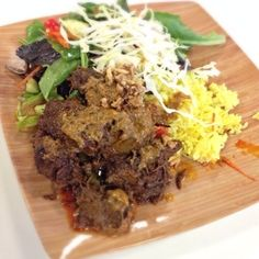 Kaffir Lime Indonesia Grill - Rendang Daging - Organic need simmered in coconut milk with galangal, cayenne, cinnamon and spices. It just far apart. - Calgary, AB, Canada