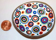 New, just added, abstract circles handpainted on a Maine beach stone...www.karlagerard.com