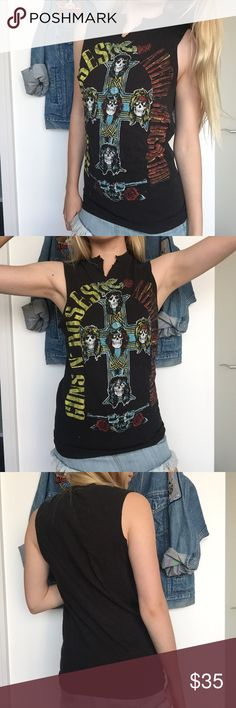 Guns N Roses Tank this shirt can't be more than 5 years old - therefore isn't true vintage, although it's still super rad! love this GNR graphic. awesome cotton statement tee.   ▪️ Model is a 24 in waist/XS, 5'3.  ▪️ ALL ITEMS ARE 100%, GUARANTEED VINTAGE AUTHENTIC. I take reselling vintage VERY seriously and do not sell anything that's not the real deal ⚡️ ❣ABSOLUTELY NO TRADES NO PP Nasty Gal Tops Muscle Tees
