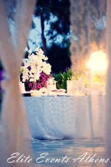 Vintage wedding in Athens - White laces and fabrics, orchids Phalaenopsis,, tulips, calas, hydrangeas and anemones were decorating the reception venue and church. Apart from the wedding cake which was a real masterpiece decorated with handmade sculpted anemones from sugar - creation of Elite Events Athens , the wish table was so special & outstanding that the guests took didn't leave not even one koufeto or wedding buiscuits that were on the table! agios dionysios, island, church, varkiza