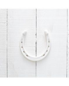A traditional symbol of luck, this porcelain horseshoe by Redraven Studios makes a perfect house warming, wedding, bridal shower, or new baby gift. Crosses Decor, Looking Forward To Seeing You, Good Luck, Painted Signs, New Baby Gifts, Jewelry Crafts, House Warming, New Baby Products, Furniture Design