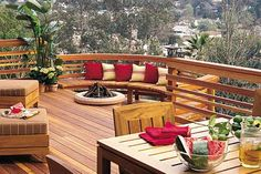 I like the deck railings, the curved sitting area and the fire pit ...deck design -