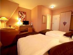 Die Classiczimmer befinden sich in der 2. Etage unseres Hotels und haben voneinander getrennt stehende Betten.