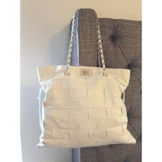 """White Chanel Quilted Leather Handbag 100% authentic Chanel Quilted Handbag. Purchased from Neiman Marcus, Ca. Includes: Dust bag, NM tags, Chanel booklets and authenticity card. Hardware is silver, gently used in good condition, corners have tiny scuffs on them from setting the bag down and no stains on the inside/outside of bag. Inside is perfect and still has plastic on the zipper pull. Kept in a smoke free home. This bag is GORGEOUS in person. 16.5"""" tall • 18"""" wide with drawstring pulls…"""