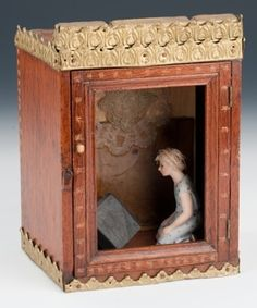 Kneeling Woman, box assemblage by artist Becki Smith, antique wooden box with metal embellishment (Nicaragua), encaustic collage, tiny Bible...