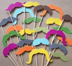 Colorful paper mustaches. Recreate using color paper or card stock and dowels or straws.   Find more cool teen program ideas at www.the4yablog.com